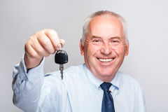 Businessman holding car key Stock Photos