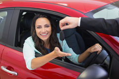 Businessman holding car keys by his fingertips Stock Photo