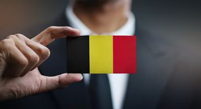 Businessman Holding Card of Belgium Flag.  stock photos