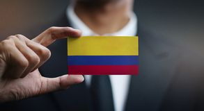 Businessman Holding Card of Colombia Flag.  royalty free stock images
