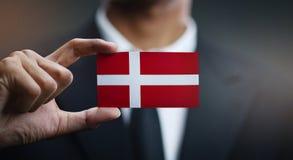 Businessman Holding Card of Denmark Flag.  stock photos