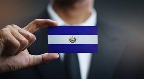 Businessman Holding Card of El Salvador Flag.  royalty free stock image
