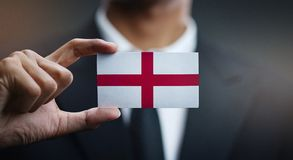Businessman Holding Card of England Flag.  royalty free stock photos