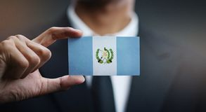 Businessman Holding Card of Guatemala Flag.  stock images