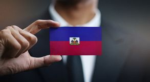 Businessman Holding Card of Haiti Flag.  royalty free stock photo