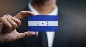 Businessman Holding Card of Honduras Flag.  royalty free stock photo