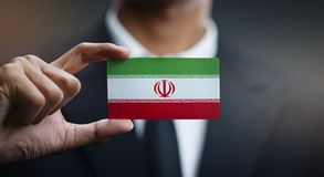 Businessman Holding Card of Iran Flag.  stock images