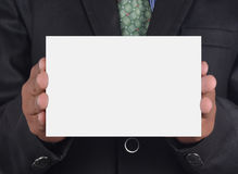 Businessman holding a card Royalty Free Stock Images