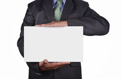 Businessman holding a card Stock Image