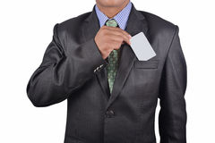 Businessman holding a card Royalty Free Stock Photo
