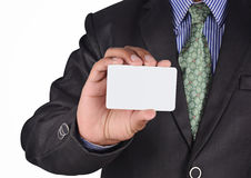 Businessman holding a card Stock Photography