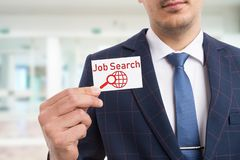 Businessman holding card as hiring concept stock image