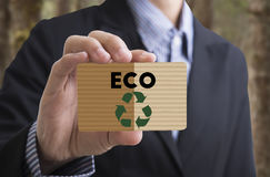 Businessman holding card message recycle, reduce, reuse. Concept environmental natural ecology Stock Photos