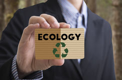 Businessman holding card message recycle, reduce, reuse. Stock Photos