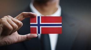 Businessman Holding Card Norway Flag.  royalty free stock images