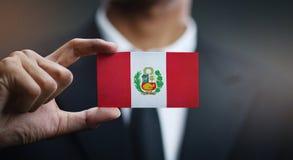 Businessman Holding Card Peru Flag.  stock photos