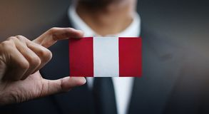Businessman Holding Card Peru Flag.  stock images