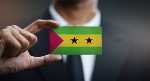 Businessman Holding Card of São Tomé and Príncipe Flag.  stock photography