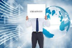 Businessman holding card saying creativity Stock Photos