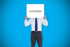 Businessman holding card saying customer Stock Image
