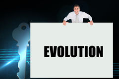 Businessman holding card saying evolution Stock Images