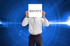 Businessman holding card saying identity Royalty Free Stock Photo