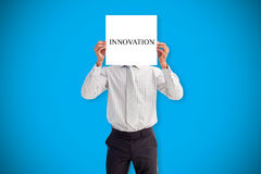 Businessman holding card saying innovation Stock Images