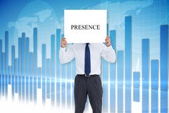 Businessman holding card saying presence Stock Image