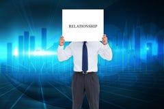 Businessman holding card saying relationship Royalty Free Stock Image