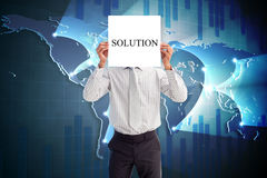 Businessman holding card saying solution Royalty Free Stock Images