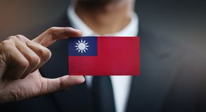 Businessman Holding Card of Taiwan Flag.  stock image