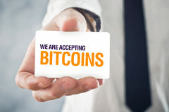 Businessman holding card with title WE ARE ACCEPTING BITCOINS Stock Image