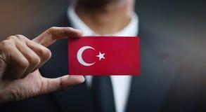 Businessman Holding Card of Turkey Flag.  stock image