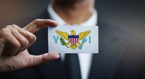Businessman Holding Card of United States Virgin Islands Flag.  stock images