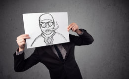 Businessman holding a cardboard with a smoking man on it in fron Stock Images