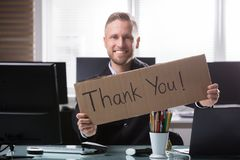 Businessman Holding Cardboard With Thank You Text stock photos