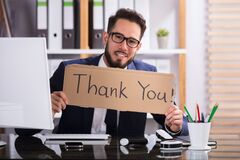 Businessman Holding Cardboard With Thank You Text