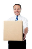 Businessman holding a carton box Royalty Free Stock Images