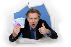 Businessman holding cash Stock Photography