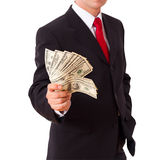 Businessman holding Cash Dollars in hands Stock Photo
