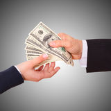 Businessman holding cash dollars in the hands Royalty Free Stock Images