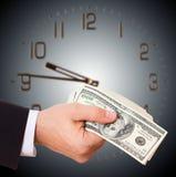 Businessman holding cash dollars in hands Stock Image
