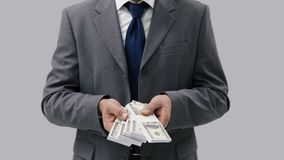 Businessman holding cash money Stock Images