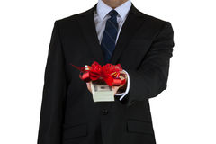 Businessman holding cash with ribbon Stock Image