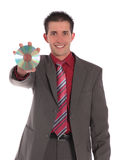 Businessman holding CD or DVD Royalty Free Stock Photos