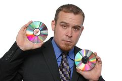 Businessman holding CDs Stock Photography