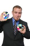 Businessman holding CDs Royalty Free Stock Image