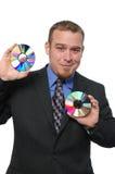 Businessman holding CDs Royalty Free Stock Image