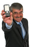 Businessman holding cell-phone. Focus is on the cell-phone Stock Images