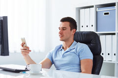Businessman holding a cell phone Stock Image
